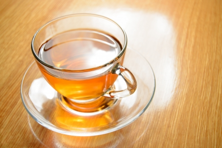 Glass Cup of Green Tea on the Wooden Table Stockfoto