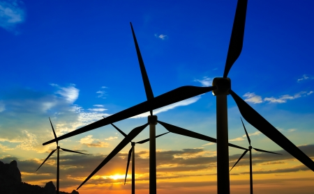 Wind Generator Turbines on Sunset - Green Renewable Energy