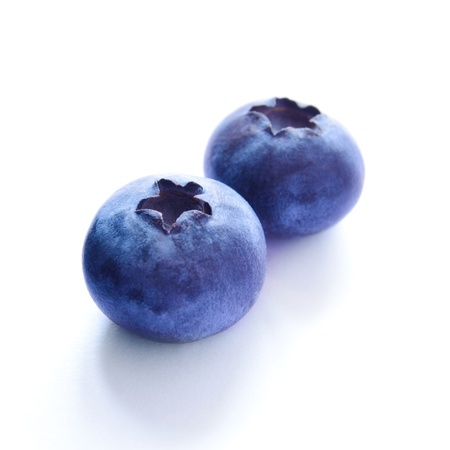 Group of Fresh Blueberries Isolated on the White Background photo