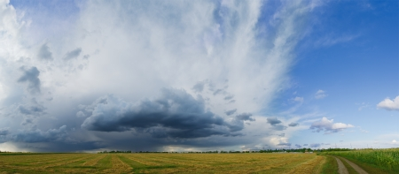 Panorama of the Beautiful Autumn Field under Stormy Sky with Dramatic Clouds photo