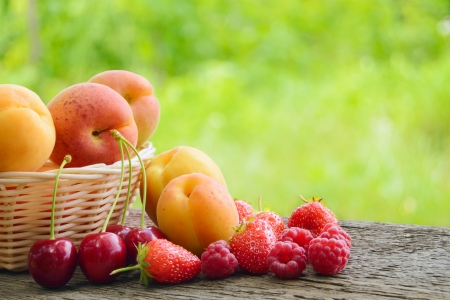 Fresh Ripe Sweet Fruits on the Wooden Table in the Garden. Fresh Organic Food Stock Photo - 21219676