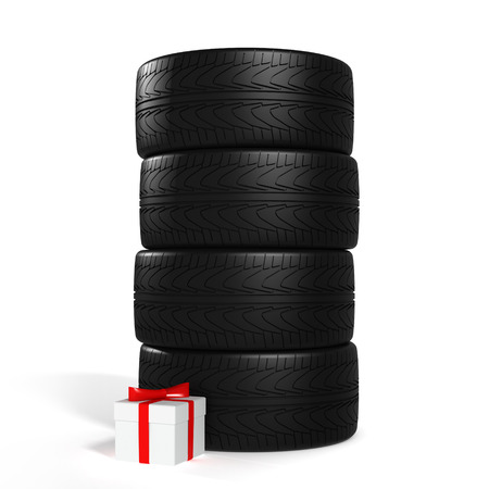 Four New Car Tires and White Gift with Red Ribbon On the White Background photo