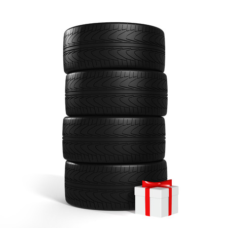 summer tires: Four New Car Tires and White Gift with Red Ribbon On the White Background