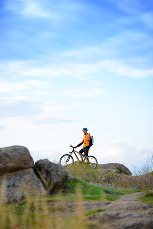 Cyclist with His Bike in the Beautiful Mountains Stock Photo
