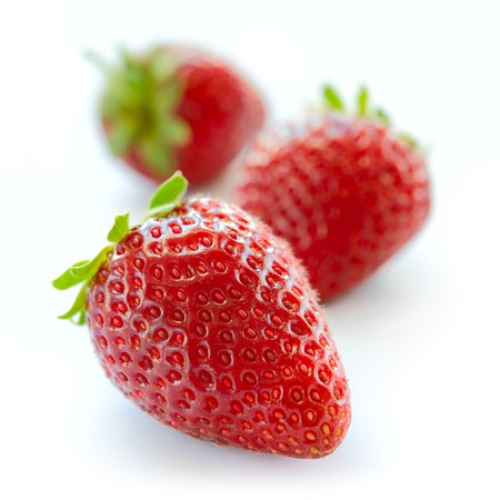 Close up of Fresh Sweet Strawberries on the White Background