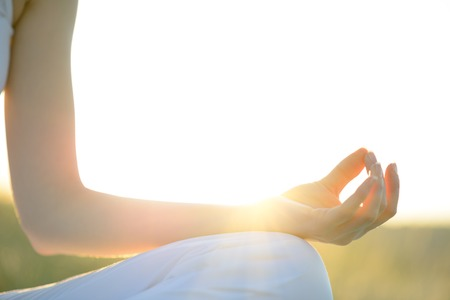 Young Beautiful Woman Practices Yoga on the Sunny Meadow  Active Lifestyle photo