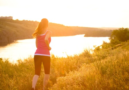 Young Beautiful Woman Running on the Mountain Trail in the Morning  Active Lifestyle