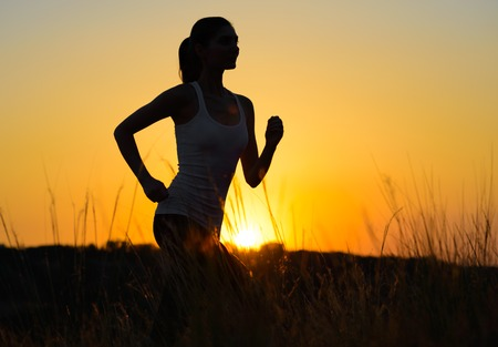 Young Beautiful Woman Running on the Mountain Trail in the Morning. Active Lifestyle photo