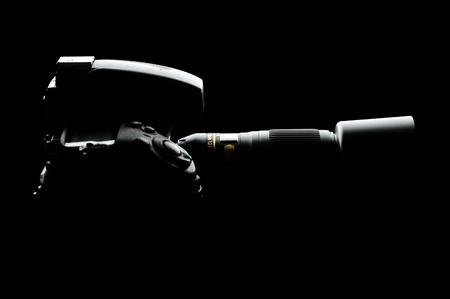 Professional Modern Full-Frame DSLR Camera with Lens on the Black Background