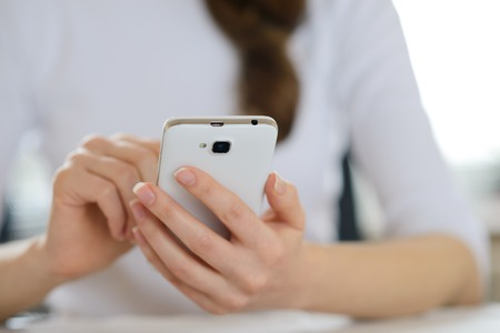 personal data assistant: Woman Using Her Mobile Smart Phone at Home. Close-up of Mobile Phone