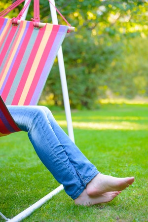 women legs: Woman Barefoot Legs on the Green Grass in the Garden