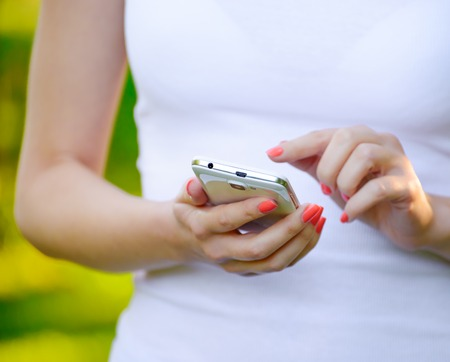personal data assistant: Woman Using her Mobile Smart Phone Outdoors