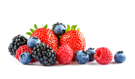 harvest: Big Pile of Fresh Berries on the White Background. Ripe Sweet Strawberry, Raspberry, Blueberry, Blackberry Stock Photo