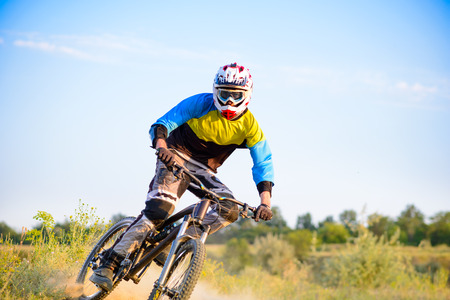 Cyclist Riding the Mountain Bike on the Trail. Extreme Sport Concept Stock Photo