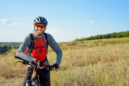 Portrait of Young Cyclist in Helmet and Glasses. Sport Lifestyle Concept. Zdjęcie Seryjne