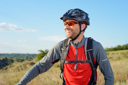 Portrait of Young Cyclist in Helmet and Glasses. Sport Lifestyle Concept. Stock Photo