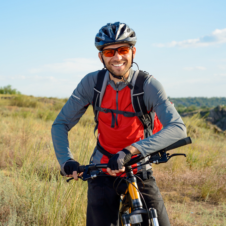 Portrait of Young Cyclist in Helmet and Glasses. Sport Lifestyle Concept. 스톡 콘텐츠