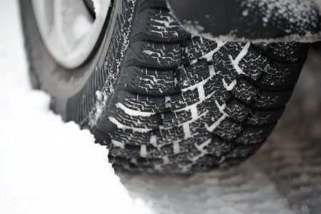 radial tire: Close-up Image of Winter Car Tire on the Snowy Road. Drive Safe Concept