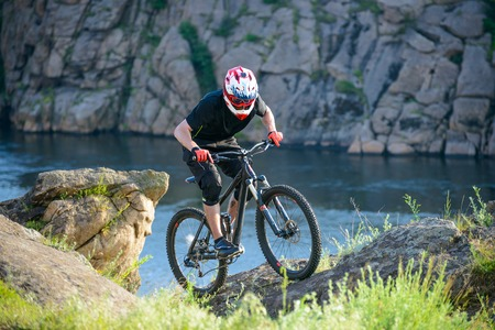 red mountain: Professional Cyclist Riding the Bike on the Beautiful Spring Mountain Trail. Extreme Sports