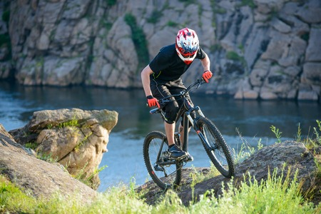bike trail: Professional Cyclist Riding the Bike on the Beautiful Spring Mountain Trail. Extreme Sports