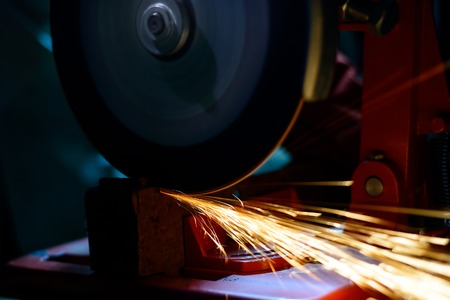 disks: Close-up of Elactric Grinder Cutting Metal with Bright Sparks Stock Photo