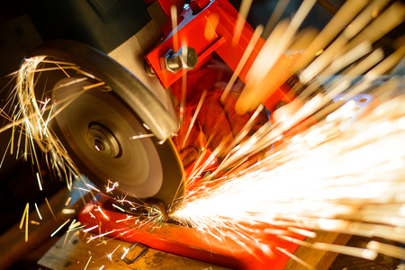 cutting metal: Close-up of Elactric Grinder Cutting Metal with Bright Sparks Stock Photo