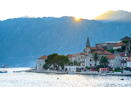 Sunset over Mountains and Famous Ancient Perast Town on Kotor Bay (Boka Kotorska), Montenegro, Europe.