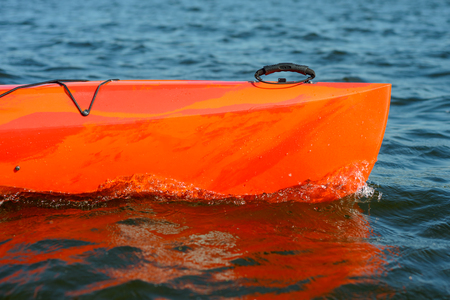 Close up Image of Red Kayak on the Beautiful River or Lake at the Evening