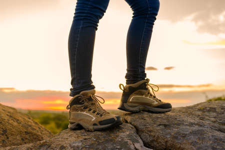 Hikers Legs on the Rocky Trail at Summer Sunset. Travel and Adventure Concept. Imagens