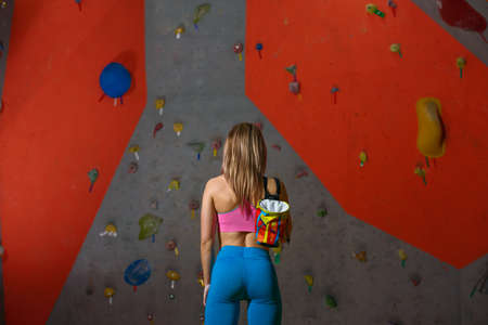 Woman Climber Prepare for Bouldering in the Climbing Gym. Extreme Sport and Indoor Climbing Concept