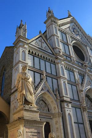 dante alighieri: Dante Alighieri statue and Basilica of the Holy Cross in the square Santa Croce in Florence, Italy