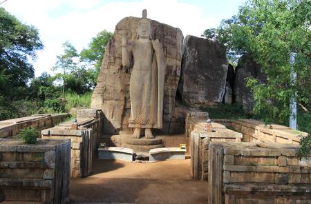 Aukana standing Buddha statues of the Buddha near Kekirawa in North Central Sri Lanka Stock Photo