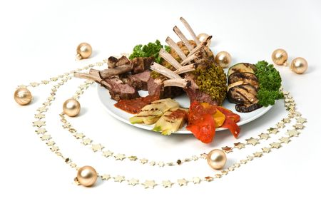 mutton chops: Mutton chops on a plate with vegetables, surrounded by Christmas decorations Stock Photo