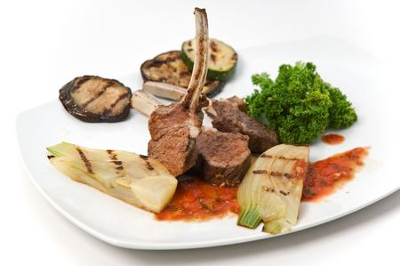 mutton chops: Mutton chops with vegetables on white plate