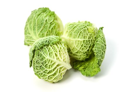 cabbage: Three small savoy cabbages on white background Stock Photo