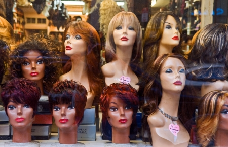 wig: Wigs displayed in a shopwindow