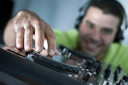 dj turntable: a DJ plays the dishes with a smile Stock Photo