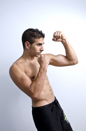 fiercely: a young man on guard Stock Photo