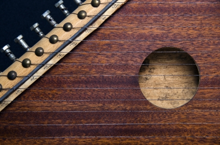 tacks: Zither, closed frame on dark Background  Stock Photo