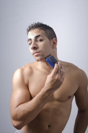 electric razor: Shaving, male beauty, on blue background