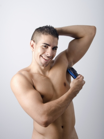 electric razor: Shaving, male beauty, on blue back ground