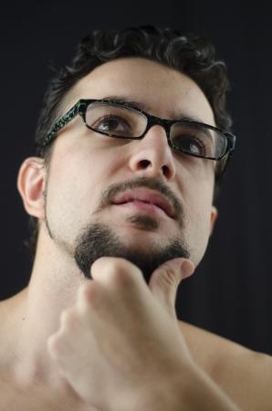 Low Key thinking man portrait