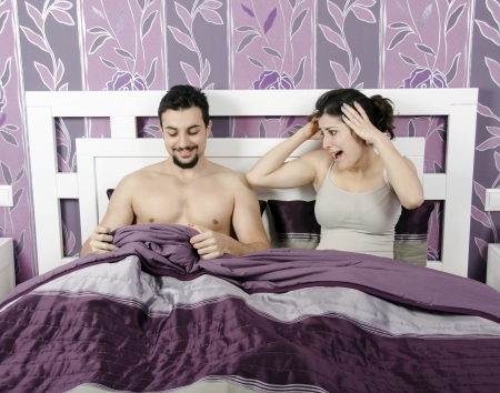 Funny couple on the bed Stock Photo