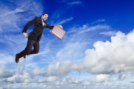 skydive: Blue cloudy sky and flying businesman