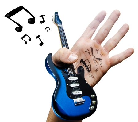 The fake rock star is a hand Stock Photo - 16974694