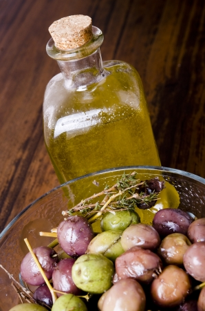 oilcan: Olive oil and olives Stock Photo