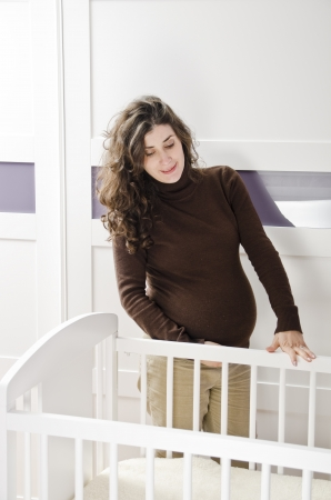 Pregnant girl looking  Stock Photo - 17288321