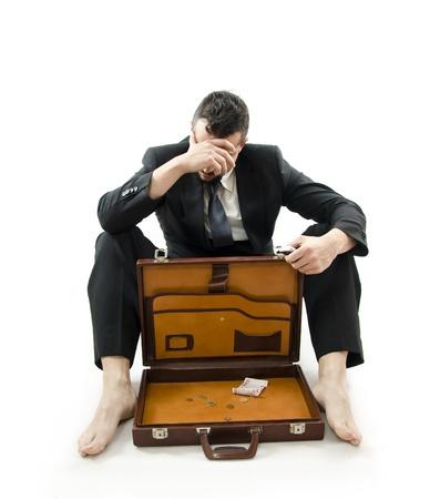 destitution: Poor rich businessman