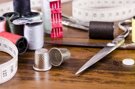 Sewing kit on wood table photo