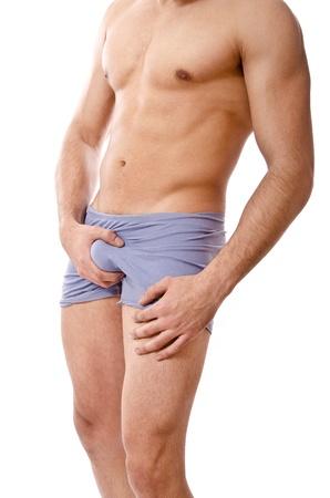 genitali: uomo che tiene il suo patrimonio